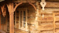 Traditional wood carvings on an old wooden house of Podhale region Poland Stock Footage
