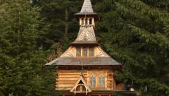 A beautiful wooden chapel in Jaszczurowka. The Zakopane Style architecture. - stock footage