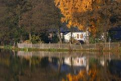 Pond and an old house - stock photo
