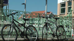 North Europe Norway City of Bergen 021 bicycles locked at a fence Stock Footage