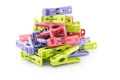 pile of colorful plastic pegs - stock photo