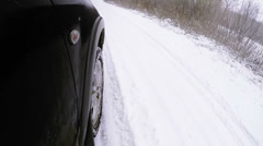Winter road front car wheel extreme driving video Stock Footage