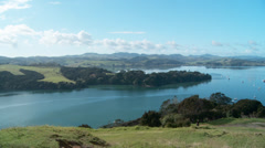 Pan of a fishing village, Bay of Islands, New Zealand Stock Footage