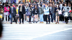 Stop go people crossing Shibuya pedestrian road crossing Tokyo Metropolis Japan Stock Footage