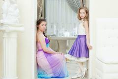 Enchanting young models posing in elegant dresses - stock photo