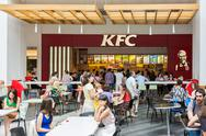 Stock Photo of People Eating At Local Kentucky Fried Chicken Restaurant