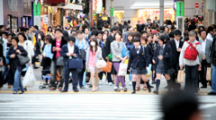 Stop go people crossing Shibuya pedestrian road crossing Tokyo Metropolis Japan - stock footage