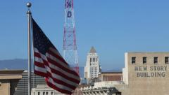 USA Los Angeles historical downtown buildings flag and historic KRKD tower Stock Footage