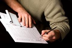 Signing the Tax Forms - stock photo