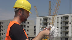 Construction worker installing wires in the building, professional tools, helmet Stock Footage