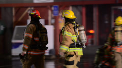 Firefighters Walking Through Scene - stock footage