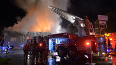 Firefighters Positioning Ladder Truck To Fight A Structure Fire Stock Footage