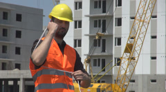 Young worker in a construction site tighten wire cable installing power energy Stock Footage