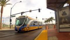 Ultra Modern Hybrid Electric Bus Toward And Past Camera- Las Vegas NV Stock Footage