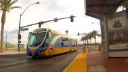 Stock Video Footage of Ultra Modern Hybrid Electric Bus Toward And Past Camera- Las Vegas NV