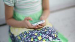 Beautiful child little girl enjoys smartphone close up. Model Elizabeth Andreeva Stock Footage