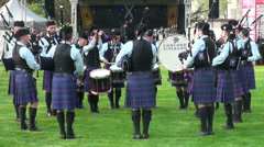 Bagpipe band with drummers at Highland Gathering Stock Footage