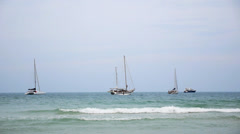 Beautiful Seaside View with Turquois Sea, Foamy Big Waves and Anchored Boats. Stock Footage