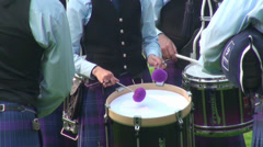 Bagpipe band drummer close up at Highland Gathering Stock Footage
