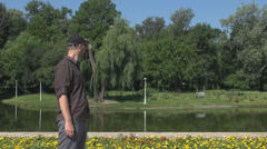 Man waiting in the park, upset irritated nervous boy because of the delay Stock Footage