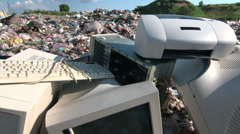 Discarded obsolete computer scrap at rubbish dump - stock footage