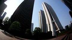 Shinjuku Mode Gakuen Cocoon skyscraper city Tokyo Japan Stock Footage