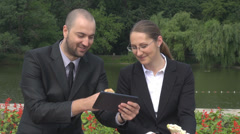 Trainee students with tablet dressed in business suits having a sandwich Stock Footage