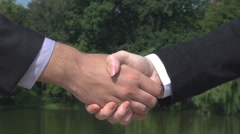 Business woman and man handshaking for a good deal, fulfilled negotiations Stock Footage