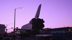 Shuttle Endeavor rolls through the streets of Los Angeles HD Stock Footage
