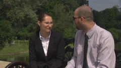 Stock Video Footage of Successful man and woman with opposite ideas arguing in park being both upset