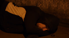 Young Man Sleeps Alone in Empty Underpass Stock Footage