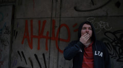 Young Male Smoke Against Graffiti Wall Stock Footage