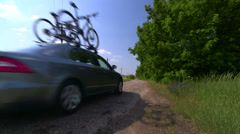 Transportation two bikes on the roof of car Stock Footage