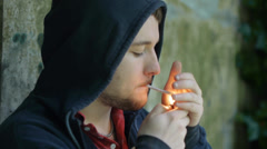 Young Man Smokes Alone in Depression - stock footage