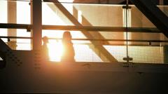 Walkway people elevated gantry Tokyo sun flare Metropolis Tokyo Japan - stock footage