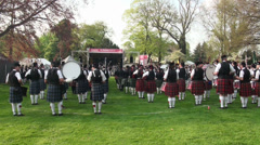 Bagpipe bands playing together at Highland Gathering Stock Footage