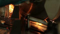 Man working cutting iron circular disk saw, making sparks Industrial work Stock Footage