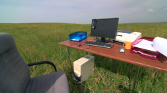 Telecommuting remote office in a green field Stock Footage