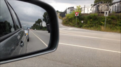 Back road reflected in car mirror Stock Footage