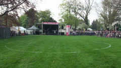 Bagpipe bands timelapse enter the competition place at Highland Gathering Stock Footage