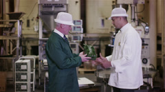 2 businessmen trading in fresh coffee shake hands on a deal - stock footage