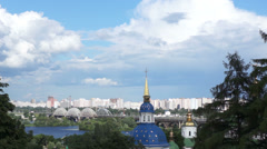 The church building on background of the city and clouds. Time lapse. Stock Footage