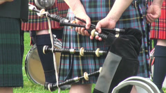 Bagpipe player holding his bagpipe close up at Highland Gathering Stock Footage