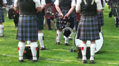 Waiting bagpipe players lower bodies at Highland Gathering Stock Footage