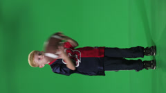 Young boy throwing football in front of green screen Stock Footage