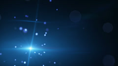 Shining blue particles and lens flare loopable background Stock Footage