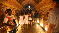 Tourists visiting the Temple of the Tooth, a Buddhist temple. Stock Footage
