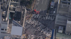 Aerial Shibuya scramble crossing commuter intersection Tokyo Asia Stock Footage
