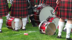 Drums of waiting bagpipe band drummers at Highland Gathering Stock Footage