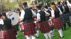 Playing bagpipe band drummers motion view Highland Gathering Stock Footage